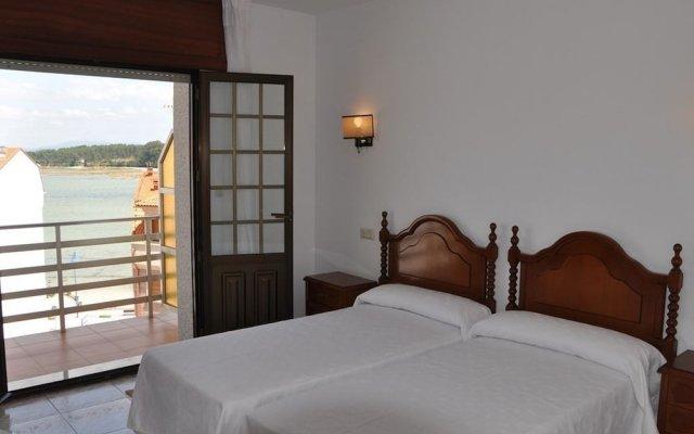 Отель Hostal Mourelos