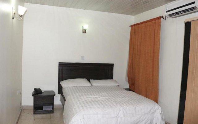 Отель Michelle Suites Нигерия, Калабар - отзывы, цены и фото номеров - забронировать отель Michelle Suites онлайн комната для гостей