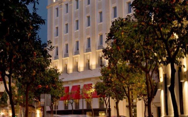 Отель Gran Meliá Colón - The Leading Hotels of the World Испания, Севилья - отзывы, цены и фото номеров - забронировать отель Gran Meliá Colón - The Leading Hotels of the World онлайн вид на фасад