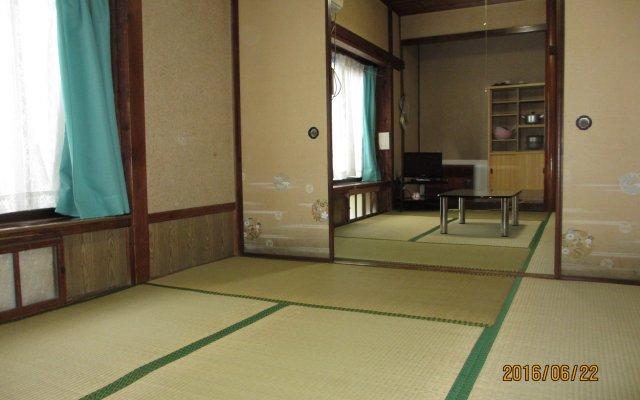 Отель Nyutokashima Yokoso Беппу комната для гостей