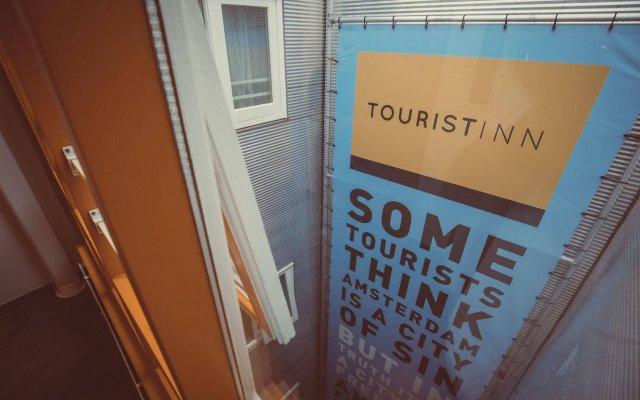 Отель Tourist Inn Budget Hotel - Hostel Нидерланды, Амстердам - 1 отзыв об отеле, цены и фото номеров - забронировать отель Tourist Inn Budget Hotel - Hostel онлайн вид на фасад