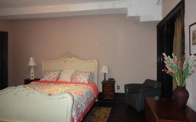Отель Sugar Hill Suites комната для гостей