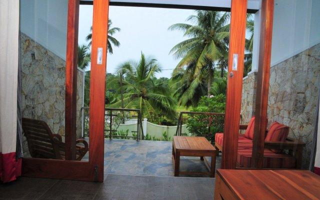 Отель Vesma Villas Шри-Ланка, Хиккадува - отзывы, цены и фото номеров - забронировать отель Vesma Villas онлайн вид на фасад
