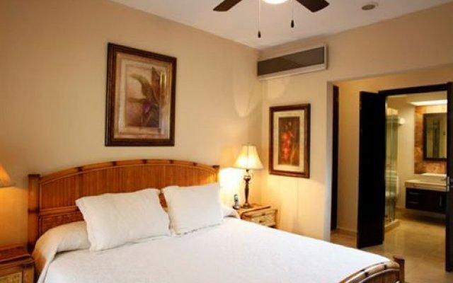 Отель Encanto El Faro Luxury Ocean Front Condo Hotel Мексика, Плая-дель-Кармен - отзывы, цены и фото номеров - забронировать отель Encanto El Faro Luxury Ocean Front Condo Hotel онлайн комната для гостей