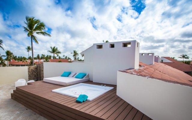 Отель Majestic Mirage Punta Cana All Suites, All Inclusive Доминикана, Пунта Кана - отзывы, цены и фото номеров - забронировать отель Majestic Mirage Punta Cana All Suites, All Inclusive онлайн вид на фасад