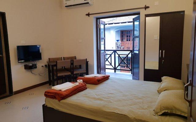 Coastal Suites Apart-Hotel Гоа комната для гостей