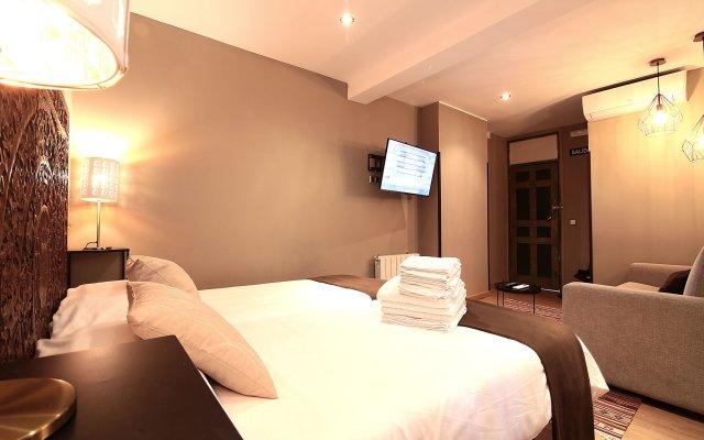 Отель Abracadabra Suites Испания, Мадрид - отзывы, цены и фото номеров - забронировать отель Abracadabra Suites онлайн комната для гостей
