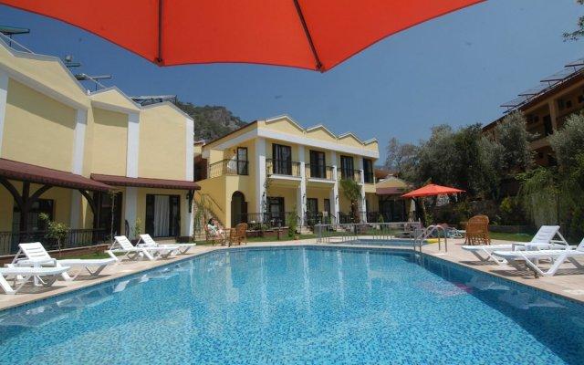 Tokgoz Butik Hotel & Apartments Турция, Олудениз - отзывы, цены и фото номеров - забронировать отель Tokgoz Butik Hotel & Apartments онлайн вид на фасад