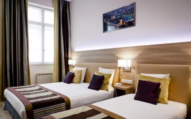 Отель Le Phénix Hôtel Франция, Лион - отзывы, цены и фото номеров - забронировать отель Le Phénix Hôtel онлайн комната для гостей