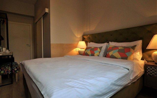 Апартаменты SleepWell Apartments комната для гостей