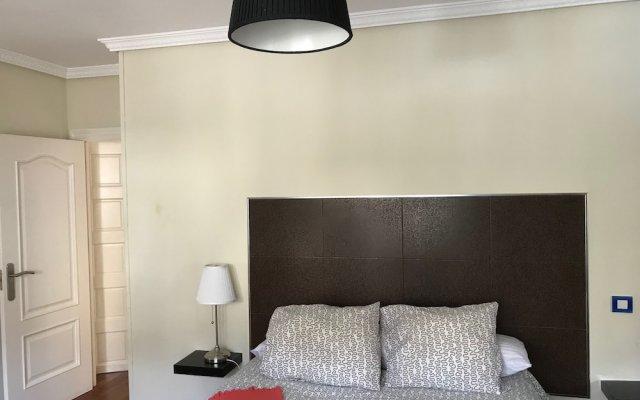 Отель Apartamentos Vintage Menéndez Pelayo комната для гостей