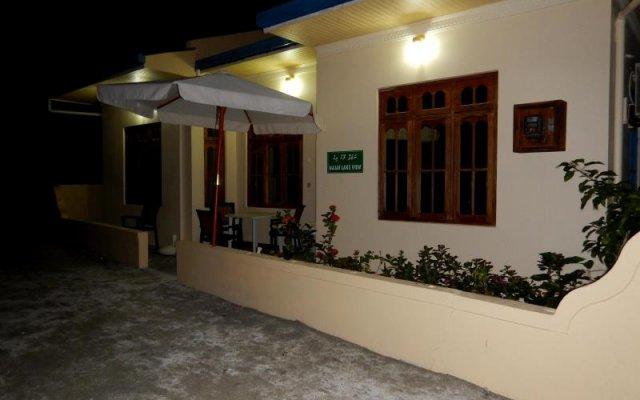 Отель Najaf Lake View Guesthouse Мальдивы, Северный атолл Мале - отзывы, цены и фото номеров - забронировать отель Najaf Lake View Guesthouse онлайн вид на фасад
