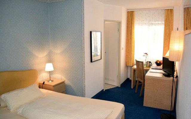 Отель Lex im Gartenhof Германия, Мюнхен - отзывы, цены и фото номеров - забронировать отель Lex im Gartenhof онлайн комната для гостей