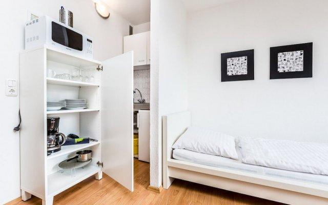 Апартаменты Apartment Höhenberg in Messenähe Кёльн комната для гостей