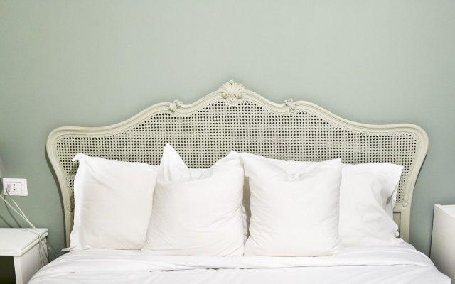 Отель La Piazzetta Rooms Генуя комната для гостей