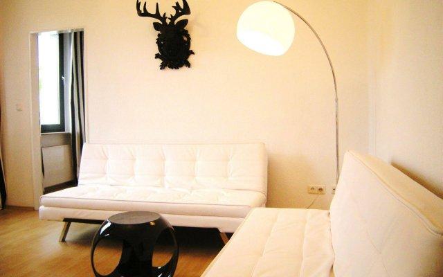 Отель A-partment Basic Кёльн комната для гостей