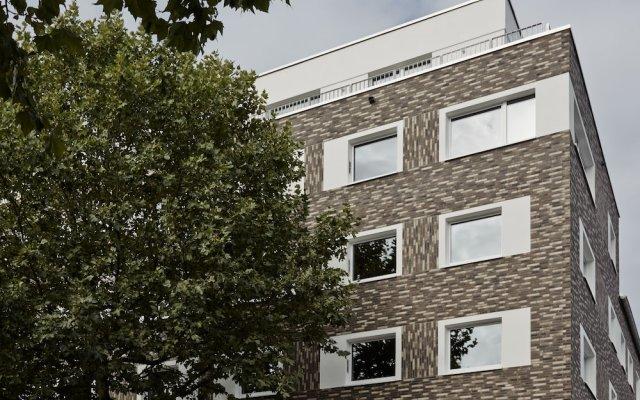 Отель ipartment Concrete Köln Mülheim Кёльн вид на фасад