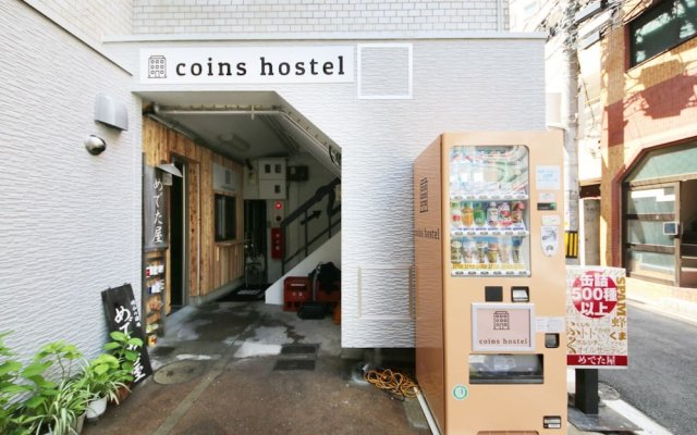 Coins Hostel Tenjin Фукуока вид на фасад