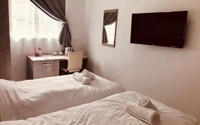 Отель Napoli Suites Мальта, Сан Джулианс - отзывы, цены и фото номеров - забронировать отель Napoli Suites онлайн