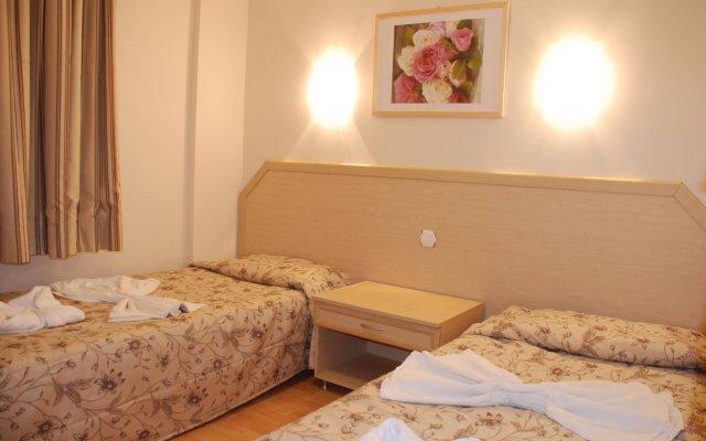 Апарт- Tuntas Suites Altinkum Турция, Алтинкум - отзывы, цены и фото номеров - забронировать отель Апарт-Отель Tuntas Suites Altinkum онлайн комната для гостей