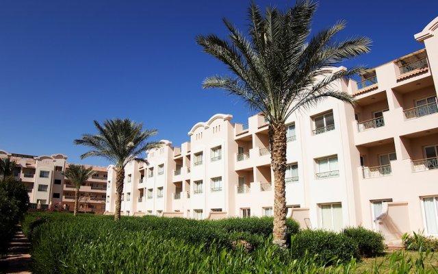 Апартаменты Pyramisa Sunset Pearl Apartments вид на фасад