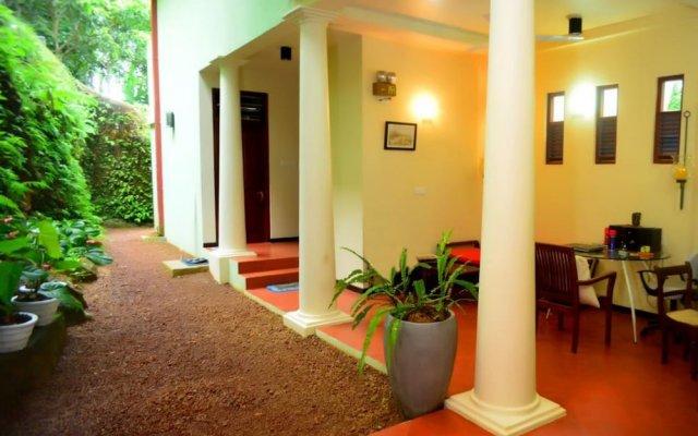Отель Tropical Retreat вид на фасад