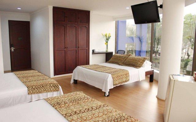 Отель Metropolis Plaza Колумбия, Кали - отзывы, цены и фото номеров - забронировать отель Metropolis Plaza онлайн комната для гостей