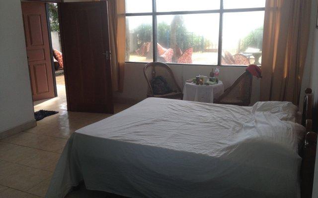 Отель Marigold Beach House комната для гостей
