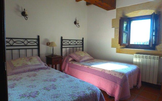 Отель Apartamentos El Lagar de Somo комната для гостей