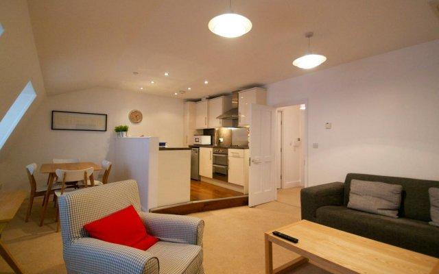 Апартаменты Gower Street Apartments Лондон комната для гостей