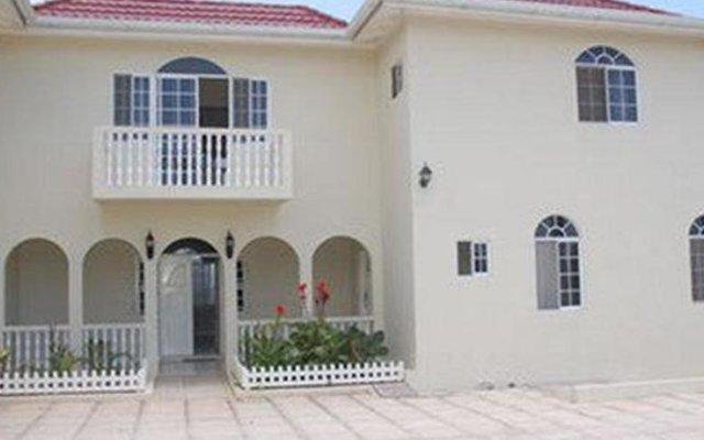 Отель Retreat Guest House Ямайка, Дискавери-Бей - отзывы, цены и фото номеров - забронировать отель Retreat Guest House онлайн вид на фасад