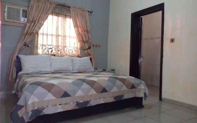 Отель Akma Signature Hotel & Suites Нигерия, Ибадан - отзывы, цены и фото номеров - забронировать отель Akma Signature Hotel & Suites онлайн комната для гостей