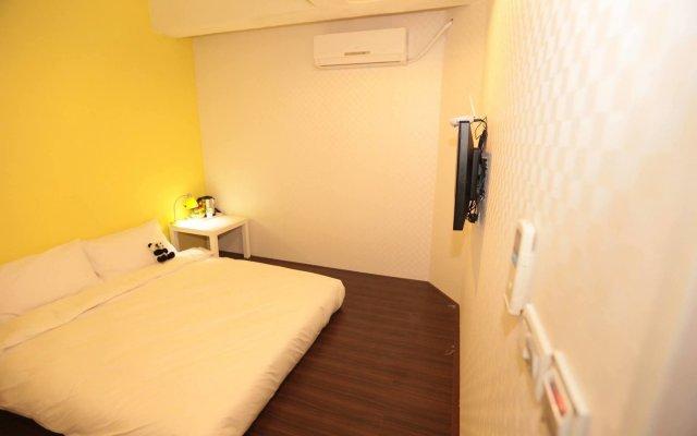 Отель G9 stay комната для гостей