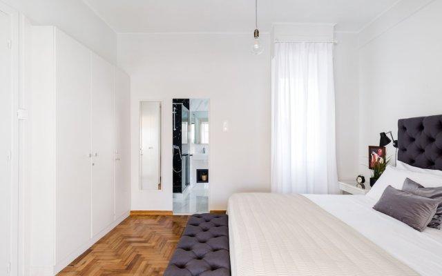 Апартаменты UPSTREET Classy Apartments Афины комната для гостей