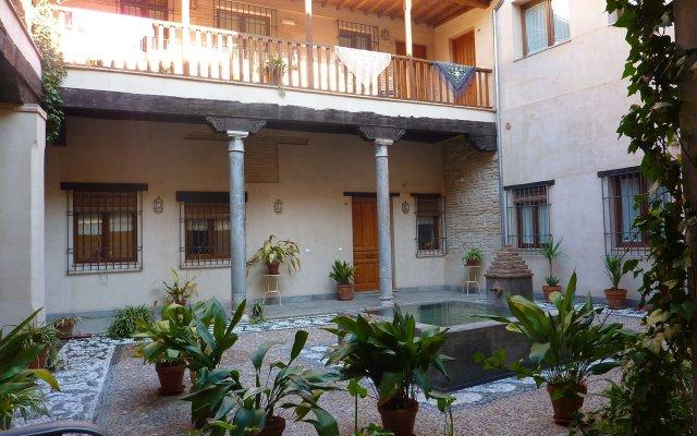 Отель Abadia Suites вид на фасад