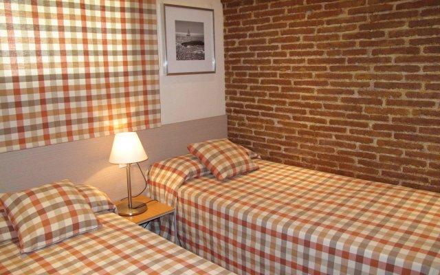 Отель Serennia Cest Apartamentos Arc de Triomf Испания, Барселона - 1 отзыв об отеле, цены и фото номеров - забронировать отель Serennia Cest Apartamentos Arc de Triomf онлайн комната для гостей
