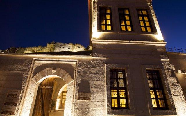Отель Kayakapi Premium Caves - Cappadocia вид на фасад