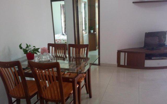 Апартаменты Leyi Family Apartment комната для гостей