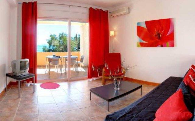 Апартаменты Glyfa Apartments комната для гостей
