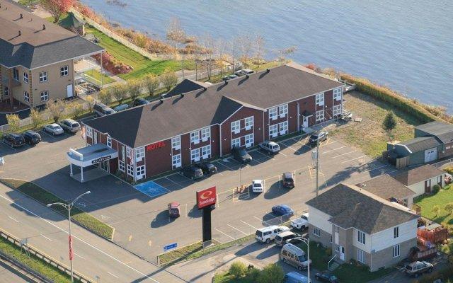 Отель Econo Lodge Montmorency Falls Канада, Буашатель - отзывы, цены и фото номеров - забронировать отель Econo Lodge Montmorency Falls онлайн вид на фасад