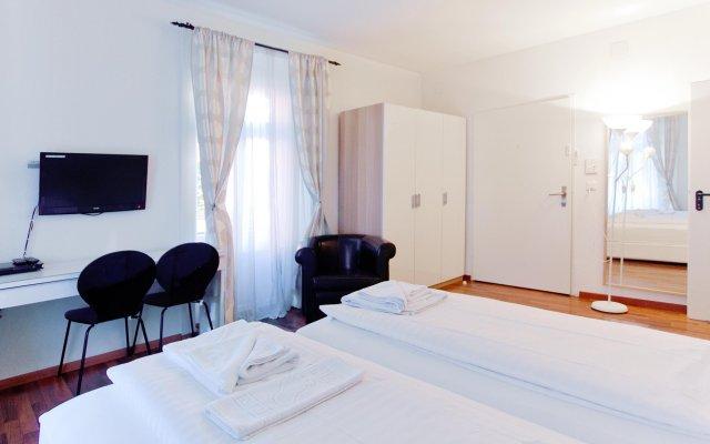 Апартаменты Comfort Apartments By Livingdowntown Цюрих комната для гостей