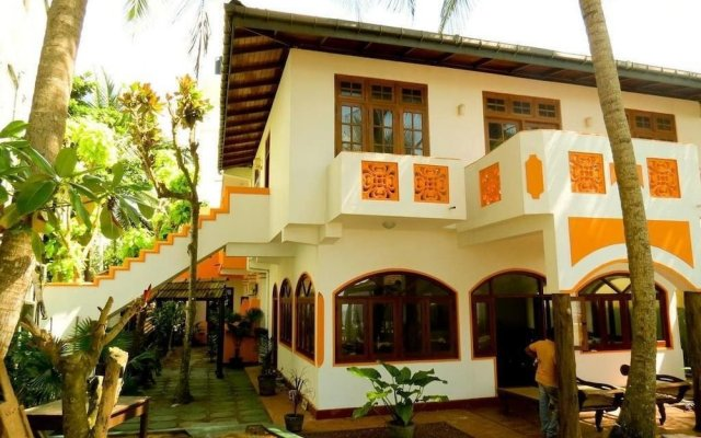 Отель Villa Paradise Хиккадува вид на фасад