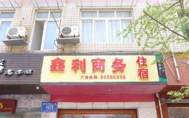 Xinli Business Hotel вид на фасад