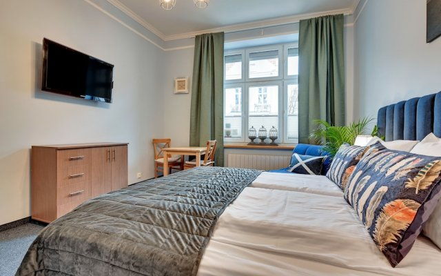 Апартаменты Lion Apartments - Sopockie Klimaty комната для гостей