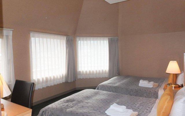 Отель 1-2-3 Kobe Кобе комната для гостей