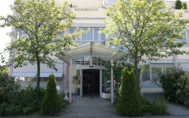 Отель Arthotel ANA Munich Messe вид на фасад