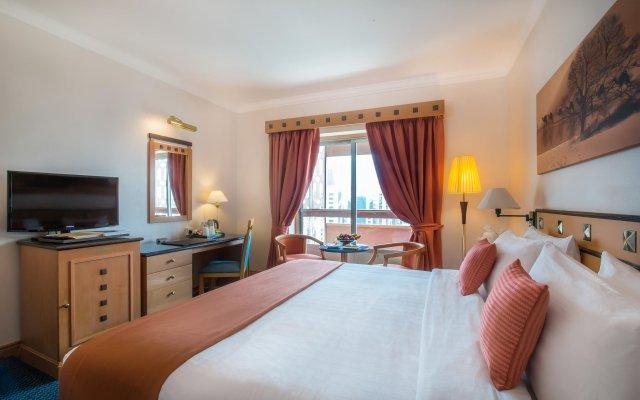 Отель Holiday International Sharjah ОАЭ, Шарджа - 5 отзывов об отеле, цены и фото номеров - забронировать отель Holiday International Sharjah онлайн комната для гостей