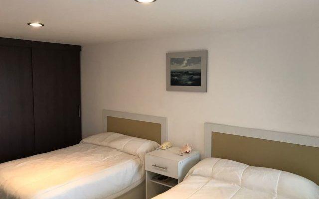Отель Departamento Real de Palmas комната для гостей