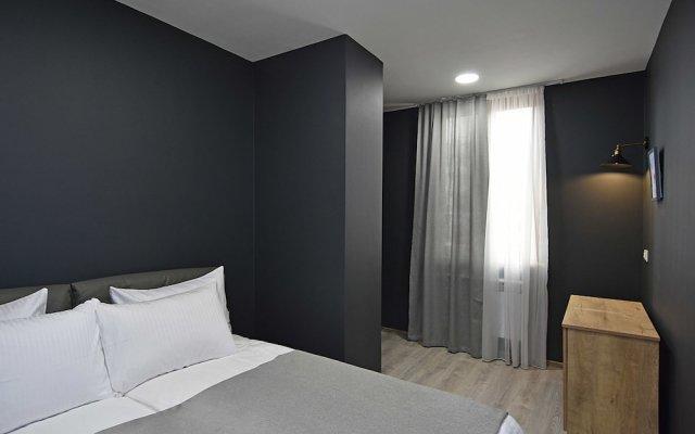 Апартаменты Gallery Apartments B комната для гостей