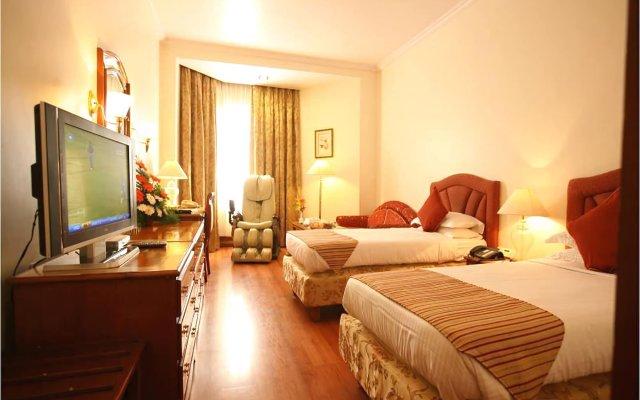 Отель The Capitol комната для гостей